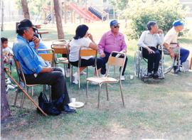 Fire evacuees sitting in the park