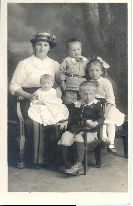 Unidentified mother with four small children