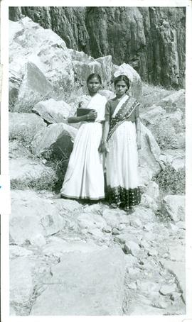 Two East-Indian women standing on some rocks
