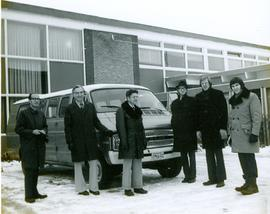 Faculty starting the van