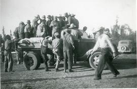 Men getting onto a truck