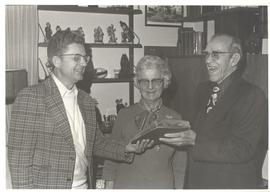 Photograph of Herbert Giesbrecht receiving archival material