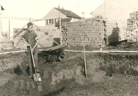 Alfred Wiebe digging foundation for the house