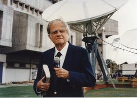 Billy Graham with a mic in hand