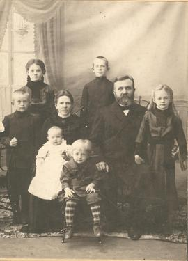 Henry H. and Anna Unruh with their family