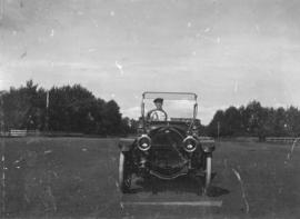 C.F. Klassen driving his father's first automobile