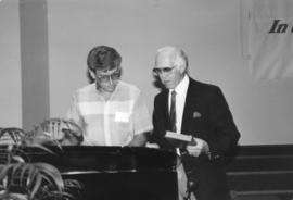 Walter Janzen and Rudy Baerg at the piano