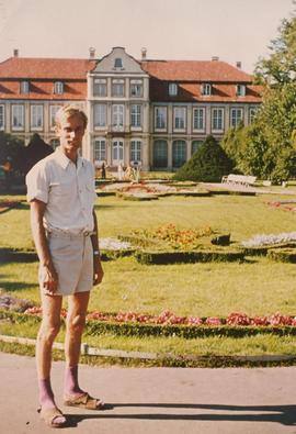 Alfred Wiebe standing in front of Opatow Palace (Abbott's Palace) in Oliwa, Danzig.