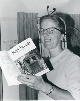A. Martha Denlinger with her book