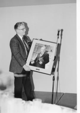 Herb Giesbrecht holding a framed picture