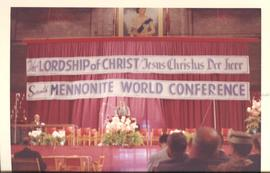 Photograph of the motto and stage of the Mennonite World Conference