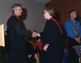 John H. Unger giving Amy Roebuck her diploma