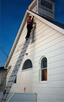 Painting the church building at Cranberry Portage