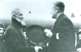 Minister J. Janzen greets the German messenger (Gesandter)