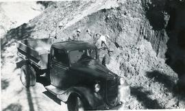 Truck and men working at excavation