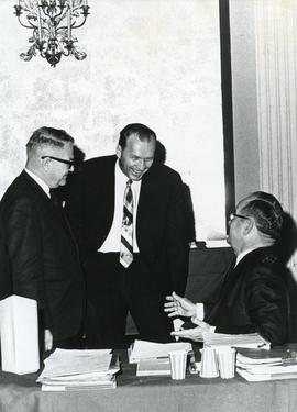 J. H. Unruh, Dwight Wiebe, and William T. Snyder