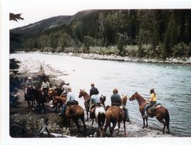 Riding horses by a river