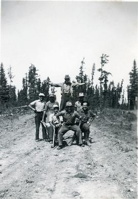 Seven working men posing for photo