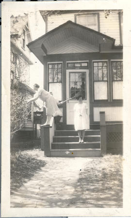 Three women in front of house