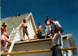 Men working on the roof at Cranberry Portage