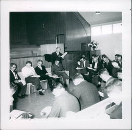 Henry Kornelson, standing, giving an SBI presentation to Conference Council; 2 photos