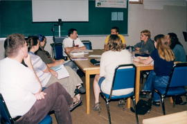 John Koop at head of table during discussion with students at Post-secondary Students' meeting