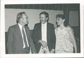 Cornie B. Loewen with unidentified couple