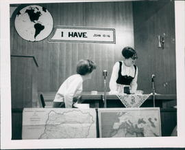 Agatha Fast (left) and Margaret Neufeld in a skit on life in Germany
