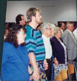 Congregational singing.  Kim and Bruce Penner in foreground
