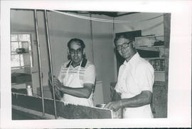 Peter Dyck and Leonarad Barkman, in the kitchen