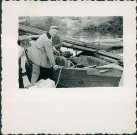 Stanford Penner boarding boat to go to teach at Pelican Rapids. Present-day site of Steep Rock Bay Bible Camp