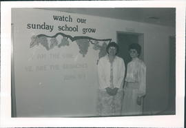 Marge Hildebrand, Sunday School Superintendent with unidentified person