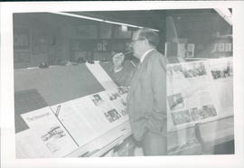 Dave Schellenberg checking paste-up of final Messenger issue of 1987