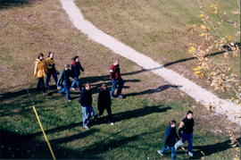 Leaders explore Pinawa Dam site (photo taken of them from above)
