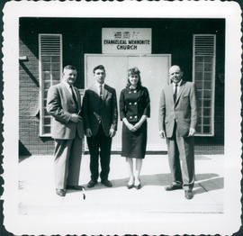 Rev. Frank D. Reimer, left, and Rev. Dave K. Schellenberg on right. The couple in the middle is unidentified