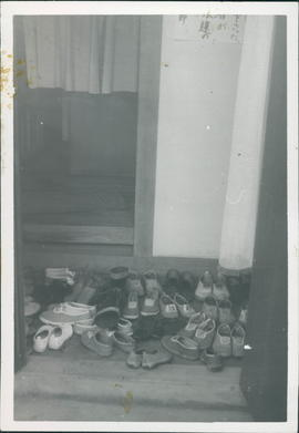 Shoes outside the entrance. Mary Koop report