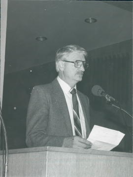 Stanford Penner, chairman of Board of Education & Publication, reporting