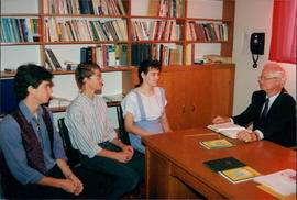 Pastor Menno Kroeker with three students