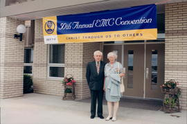Henry and Ramona Klassen with convention banner