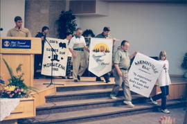 Emery Plett (microphone), church reps leaving with banners