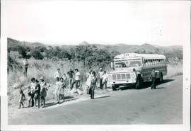 A bus was used to transport church to baptism site. Cliff Reimer report
