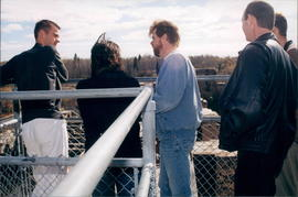 Amos Fehr (centre) and others at Pinawa Dam observation point