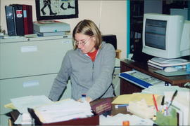 Becky Buhler, assistant editor of The Messenger, at her desk at EMC Head Office