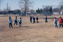 Children playing soccer at Southwood School