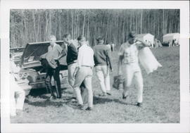 A group of young men unloading