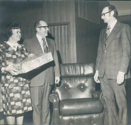 Annie Fast, Arnold Fast (retiring pastoral couple) with Henry Fast (Church Board Chairman?)