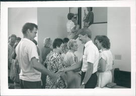 Congregation greeting John & Becky Hiebert after ordination service - 2 photos