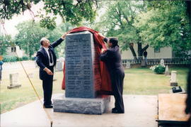 Ernie P. Toews and Hon. Yvon Dumont unveiling memorial cairn in Pioneer Cemetery