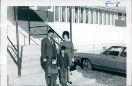 Andrew & Alma Friesen with two sons in front of Birch River Church