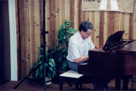 Richard Klassen, Pastor, High Level EMC (High Level Christian Fellowship) at piano